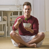 Man with bowl of salad Stock Images