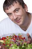 Man with a bowl of salad Royalty Free Stock Photography