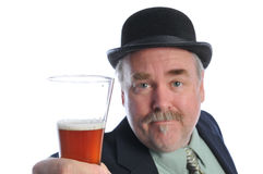 Man in bowler with glass of beer Stock Photos