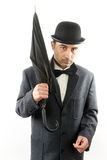 Man with bowler hat and an umbrella. Over white royalty free stock photo