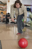 Man by bowling. Smile of man by bowling Stock Photography