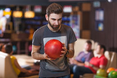 Man with bowling ball. Portrait of a bearded men with bowling ball Stock Image