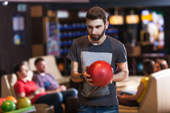 Man with bowling ball. Portrait of young bearded men with bowling ball Stock Photo