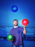Man with bowling balls Royalty Free Stock Photo