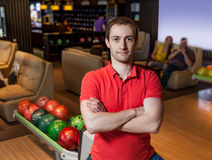 Man in bowling. Portrait of a man standing in bowling with crossed hands Royalty Free Stock Photo