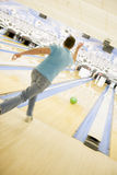 Man bowling, rear view. (blurred motion Stock Photos