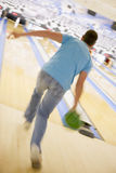 Man bowling, rear view (blurred motion).  Stock Photos