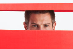 Man in box. Concerned young man stuck in red box Stock Photos