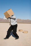 Man with a box Stock Image
