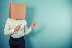 Man with box on head is pointing Stock Photography