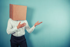 Man with box on head is pointing Stock Image