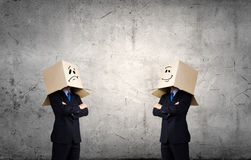 Man with box on head. Unrecognizable business people with carton boxes on head Stock Photo