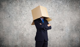 Man with box on head Stock Image