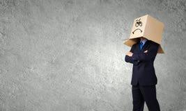 Man with box on head Stock Photo
