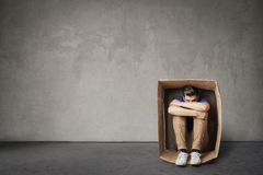 Man in a box. Man isolated in a box Royalty Free Stock Photography