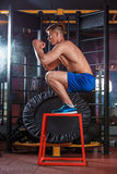 Man box jumping at a crossfit style gym. Royalty Free Stock Photography