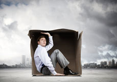 Man in box Stock Image