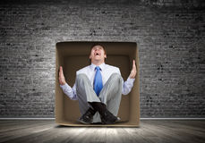 Man in box Royalty Free Stock Photo