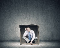 Man in box Stock Photo