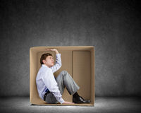 Man in box Stock Images