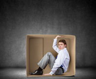 Man in box Stock Photography
