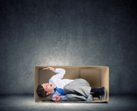 Man in box Stock Photo