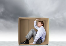 Man in box Royalty Free Stock Images