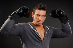Man with boxer gloves Stock Photography
