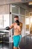 Man boxer punching at a boxing gym,Men boxer training on punching bag stock photo