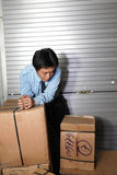 Man with boxes Royalty Free Stock Image