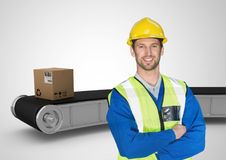man with boxes on conveyor belt Stock Photo