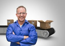 Man with boxes on conveyor belt Stock Photography