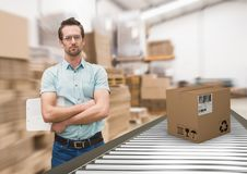 Man with boxes on conveyor belt in warehouse Royalty Free Stock Photos