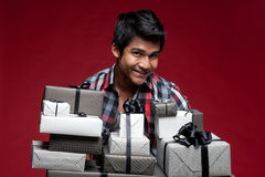 Man with boxes of presents Stock Photography