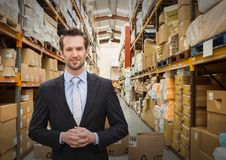 Man with boxes in warehouse. Digital composite of man with boxes in warehouse stock image