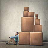 Man with boxies. Man leaning against some boxies stock photo