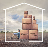 Man with boxies. Man with some boxies into a drawn house Royalty Free Stock Images