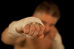 Man boxing. Posing over black background Royalty Free Stock Images