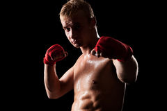 Man boxing against black background Royalty Free Stock Photography