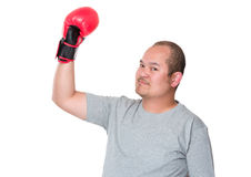 Man in boxing gloves celebrating his victory Stock Images
