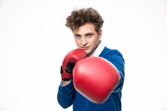Man in boxing gloves punching at the camera Royalty Free Stock Images