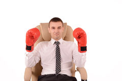 Man in boxing gloves. Sitting in an office chair stock photo