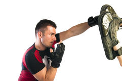 Man boxing in MMA gloves (grappling gloves) Stock Photos