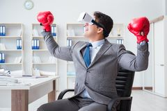 The man boxing in the office with virtual reality goggles Royalty Free Stock Photos