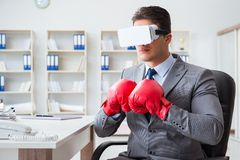 The man boxing in the office with virtual reality goggles Stock Image