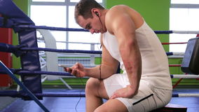 A man in the Boxing ring listening to music stock video