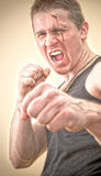 Man in a Boxing stance Stock Images