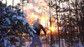 Man boxing in winter forest at sunset. Slow mo stock footage