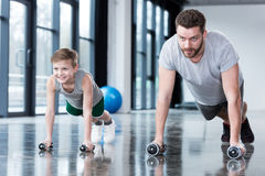 Man and boy doing push ups Royalty Free Stock Image