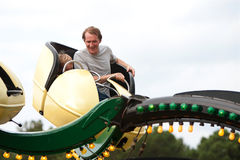 Man And Boy Enjoy Fast Moving Carnival Ride Stock Photos